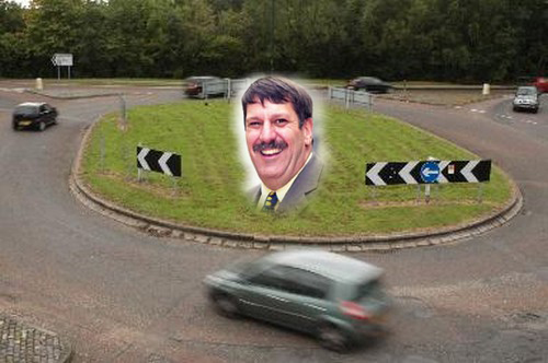 Carl Chinn's face on a roundabout